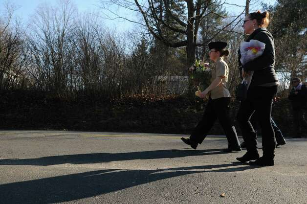 All-day-long people made the walk up to Sandy Hook Elementary School to they drop off  flowers and pay respects on Saturday, Dec. 15, 2012, to the victims of yesterday's tragic shooting in Newtown Conn. Photo: Will Waldron, Hearst Connecticut Newspapers/Wi / The News-Times