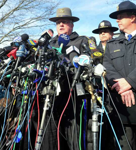 State Police spokesman J. Paul Vance speaks at a press conference about the mass shooting at Sandy H