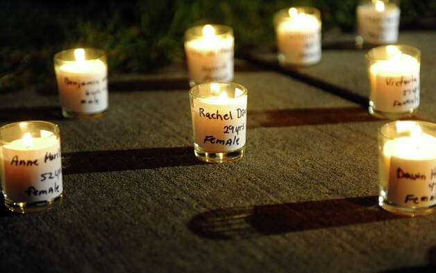 A candle memorial was laid out on the sidewalk by Nancy Orengo and her partner Nicki, as hundreds attend a candlelight vigil in memory of victims from yesterday's mass shooting in Newtown, which was held behind Stratford High School on the Town Hall Green in Stratford, Conn. on Saturday December 15, 2012. Photo: Christian Abraham / Connecticut Post