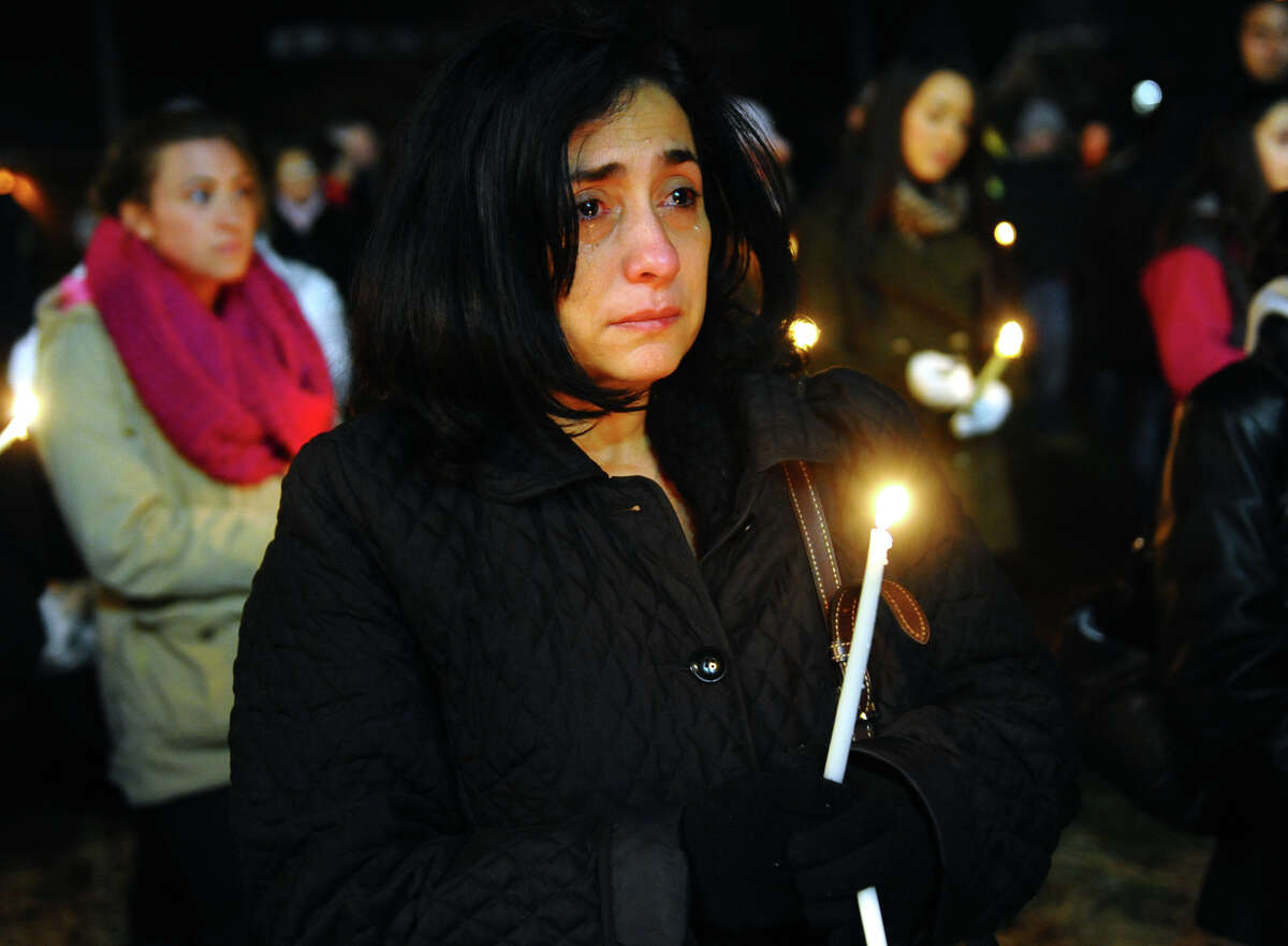 Fairfield teacher Jane Vigliotti, of Stratford, attends a candlelight vigil with hundreds of others in memory of victims from yesterday's mass shooting in Newtown, which was held behind Stratford High School on the Town Hall Green in Stratford, Conn. on Saturday December 15, 2012.