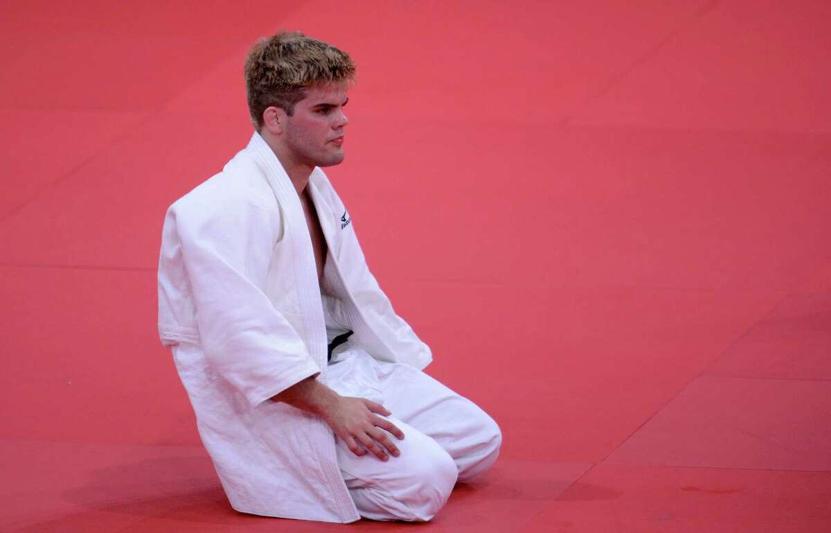 United States' Nicholas Delpopolo reacts after losing against Mongolia's Nyam-Ochir Sainjargal during their men's -73kg judo contest repechage match of the London 2012 Olympic Games on July 30, 2012 at the ExCel arena in London. AFP PHOTO / FRANCK FIFEFRANCK FIFE/AFP/GettyImages