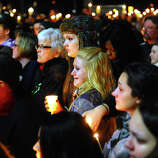 Stratford High School seniors Ally Kutzer and Caitlyn Larocque, center front, attend a candlelight vigil with hundreds of other in memory of victims from yesterday's mass shooting in Newtown, which was held behind Stratford High School on the Town Hall Green in Stratford, Conn. on Saturday December 15, 2012.