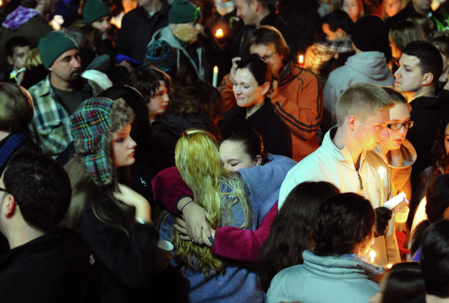 Hundreds attend a candlelight vigil in memory of victims from yesterday's mass shooting in Newtown,