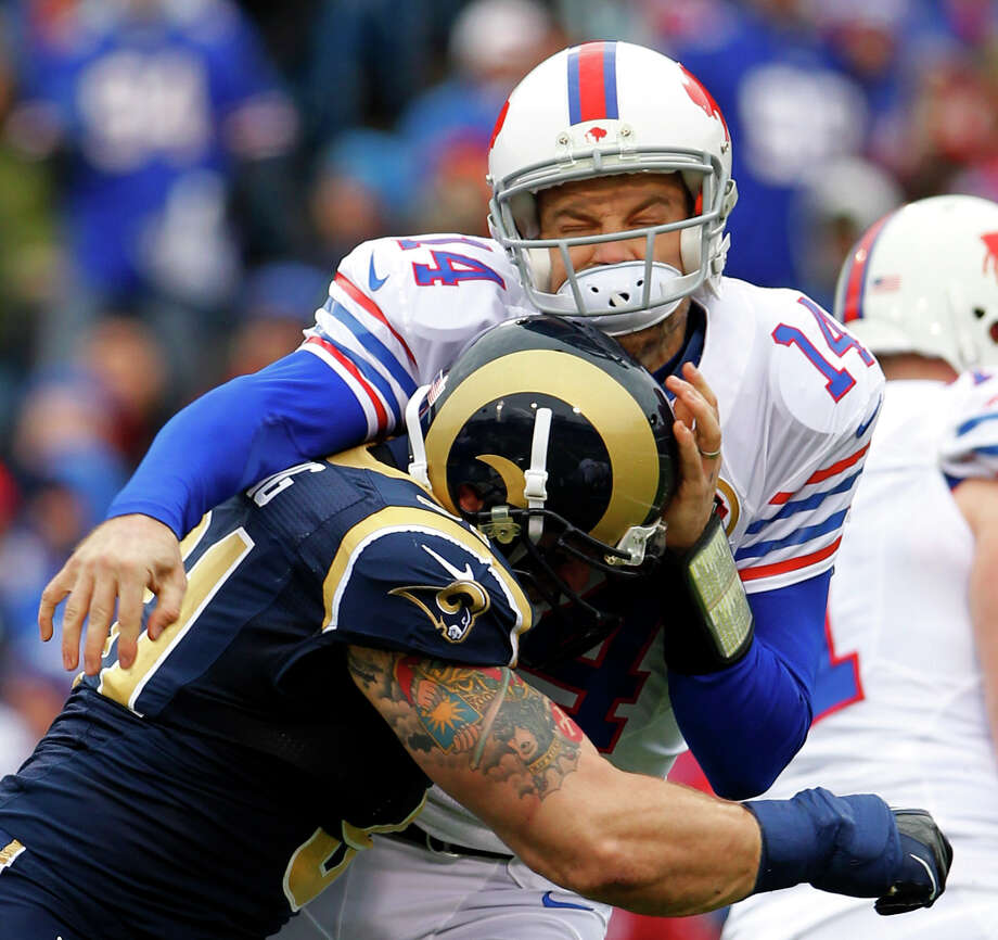 Buffalo Bills quarterback Ryan Fitzpatrick, right, is hit by St. Louis Rams defensive end Chris Long during the first half of an NFL football game, Sunday, Dec. 9, 2012, in Orchard Park, N.Y. (AP Photo/Bill Wippert) Photo: Bill Wippert