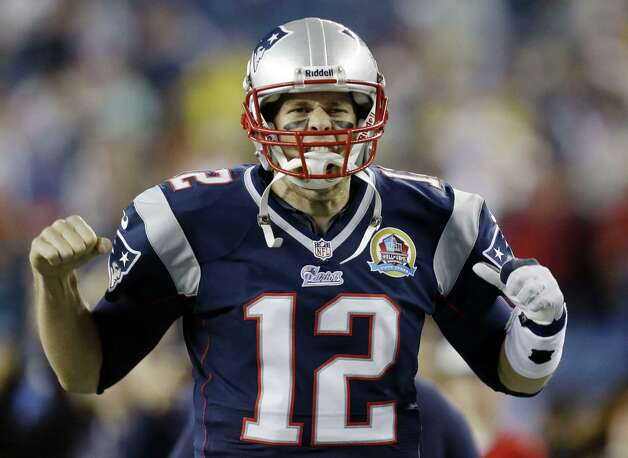 New England Patriots quarterback Tom Brady reacts as he runs onto the field before an NFL football game against the Houston Texans in Foxborough, Mass., Monday, Dec. 10, 2012. (AP Photo/Elise Amendola) Photo: Elise Amendola