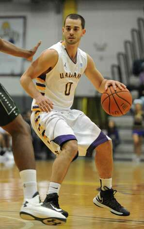 UAlbany's Jacob Iati looks for an open player during a basketball game against Wagner at the SEFCU Arena Monday, Nov. 26, 2012 in Albany, N.Y. (Lori Van Buren / Times Union) Photo: Lori Van Buren / 00020103A