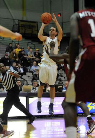 UAlbany's Jacob Iati shoots for a three pointer during their game against S.C. State at the SEFCU Arena in Albany , NY Wednesday Dec. 12, 2012. (Michael P. Farrell/Times Union) Photo: Michael P. Farrell / 00020106A