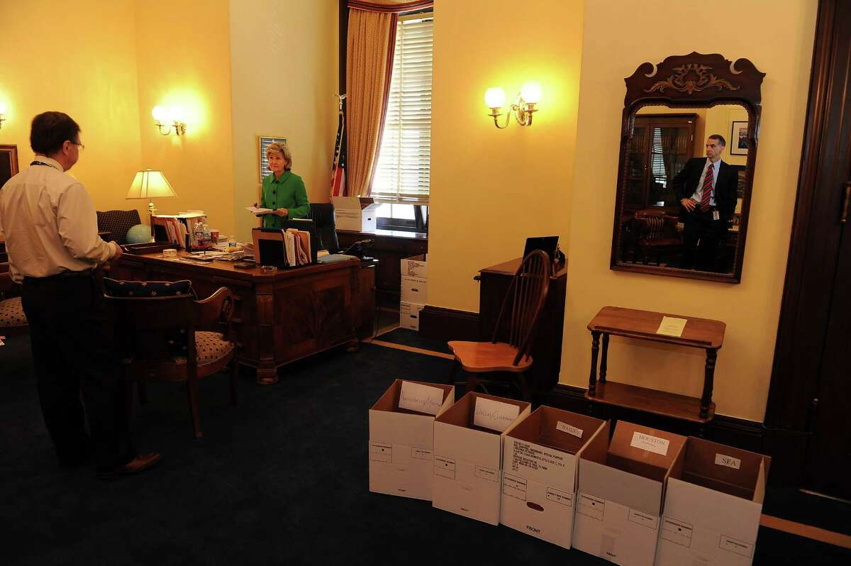 L-R, Chief of Staff Cliff Shannon, speaks to Retiring Sen. Kay Bailey Hutchison, R-TX. while Communications Director, Dean Pagani, looks on in her office near packing boxes in the Russell Senate Office Building on Capitol Hill in Washington, D. C., Thursday, December 13, 2012. Photographs by Mary F. Calvert