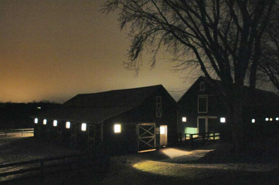 View of some of the barns of McMahon Thoroughbreds farm on the night of March 19, 2006, shot at 9:43 p.m. The colt was born around 8 pm on that night. The colt is descended from famed Triple Crown winner Secretariat.  (Philip Kamrass / Times Union) Photo: PHILIP KAMRASS / ALBANY TIMES UNION