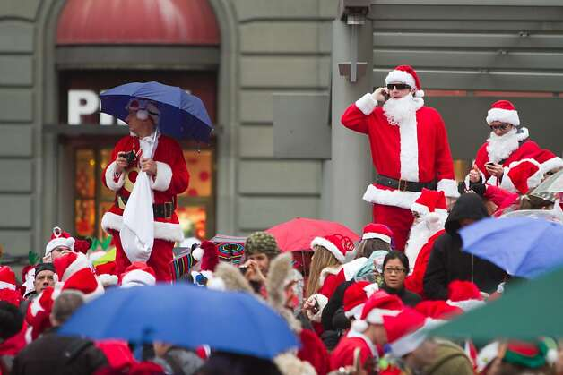 Hundreds of revelers dressed as Santa Claus fill up Union Square on Saturday Dec. 15, 2012 in San Francisco, Calif.  Most then took off around several city neighborhoods on a holiday inspired pub crawl. Photo: Douglas Zimmerman, SF Gate