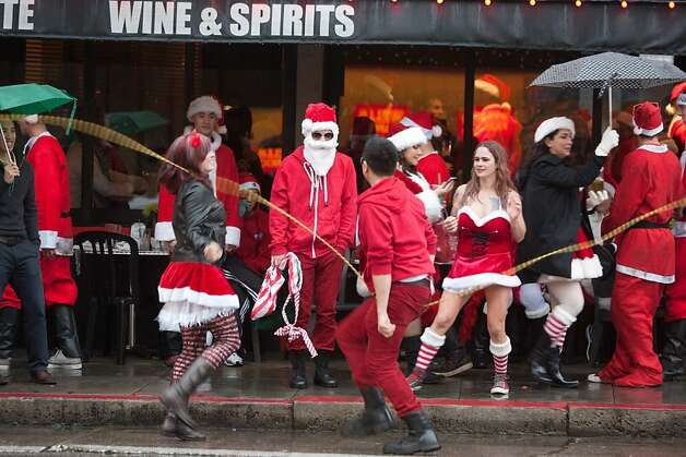 Several Santas jump rope along Broadway in North Beach during Santacon on Saturday Dec. 15, 2012 in San Francisco, Calif.  Thousands of revelers, most dressed as Santa Claus, meet up at Union Square and then took off around several city neighborhoods on a holiday inspired pub crawl. Photo: Douglas Zimmerman, SF Gate