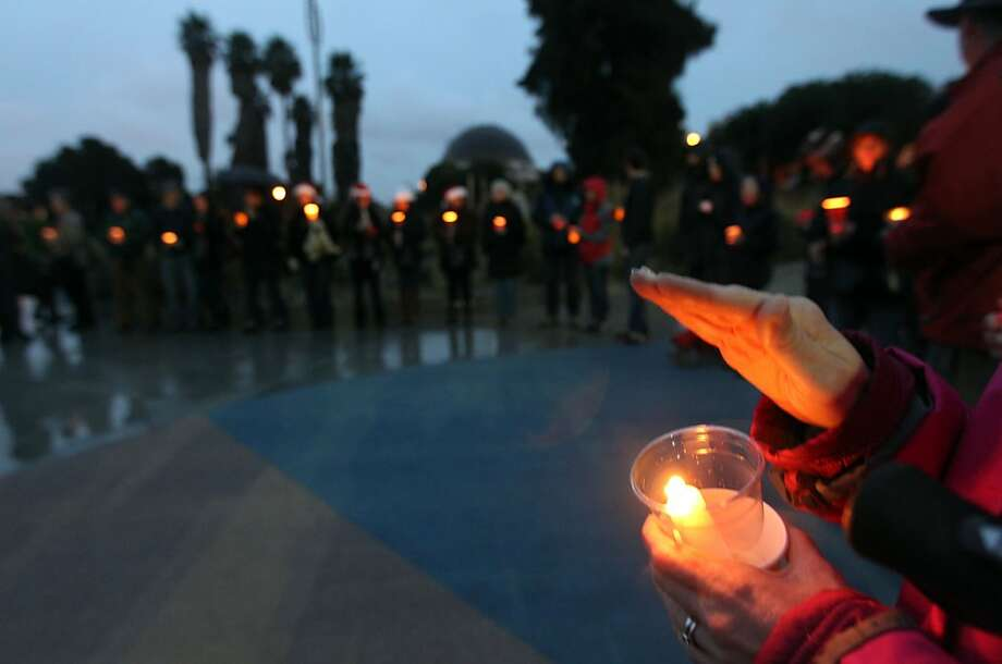 People take part in a candlelight vigil in San Francisco's Dolores Park in memory  of the Connecticut school shooting victims. Photo: Lance Iversen, The Chronicle
