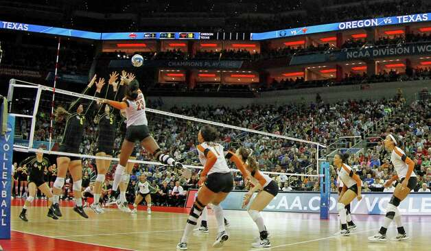 Texas outside hitter Bailey Webster (23) spikes the ball past the double block by Oregon's Liz Brenner (6) and Canace Finley (5) in the finals of the NCAA college women's volleyball tournament in Louisville, Ky., Saturday, Dec. 15, 2012. (AP Photo/Garry Jones) Photo: Garry Jones, Associated Press / FR50389 AP
