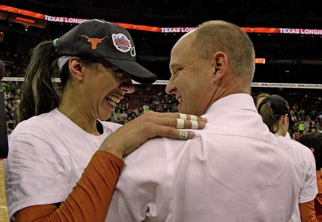 Texas coach Jerritt Elliott, right, and sophomore outside hitter Haley Eckerman embrace after defeating Oregon in the finals of the NCAA college women's volleyball tournament in Louisville, Ky., Saturday, Dec. 15, 2012.  (AP Photo/Garry Jones) Photo: Garry Jones, Associated Press / FR50389 AP
