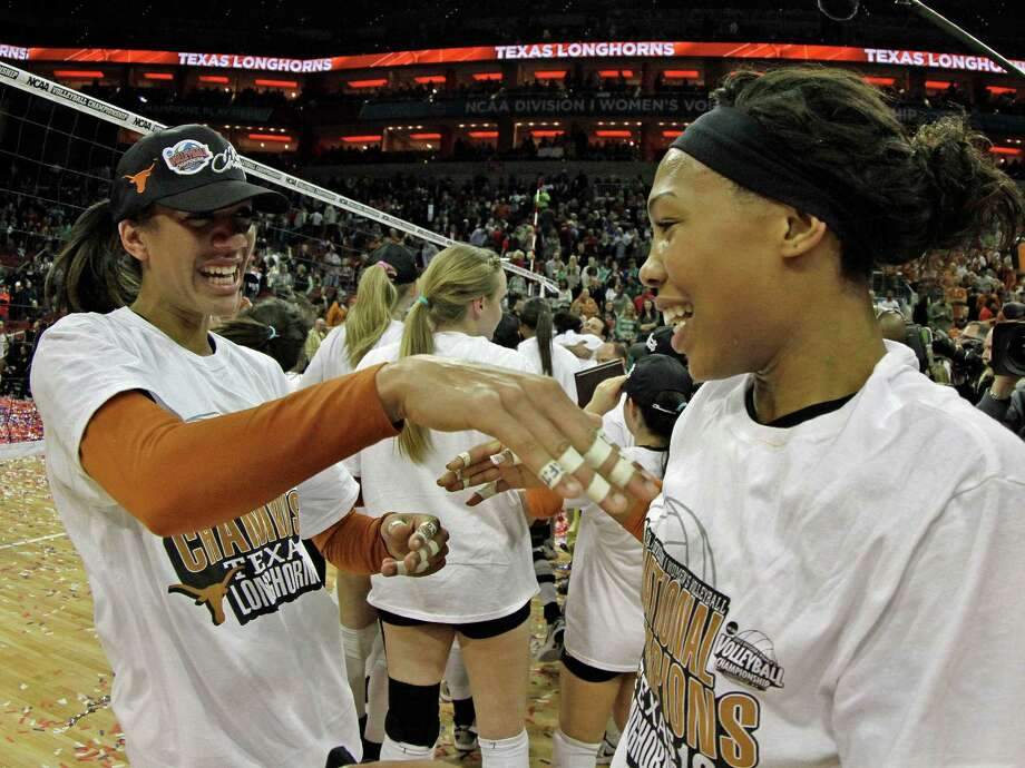 Texas' Haley Eckerman, left, and Khat Bell celebrate after defeating Oregon in the finals of the NCAA college women's volleyball tournament in Louisville, Ky., Saturday, Dec. 15, 2012.  (AP Photo/Garry Jones) Photo: Garry Jones, Associated Press / FR50389 AP