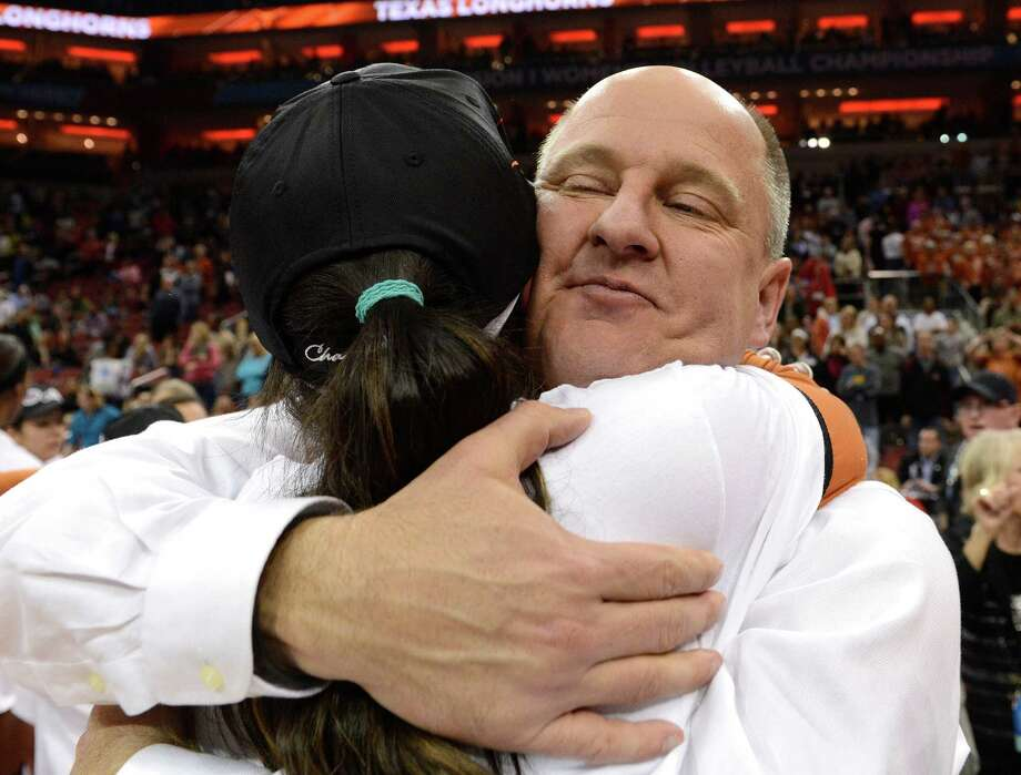 Texas coach Jerritt Elliott, right, hugs Bailey Webster after winning the NCAA college women's volleyball tournament against Oregon, Saturday, Dec. 15, 2012, in Louisville, Ky. (AP Photo/Timothy D. Easley) Photo: Timothy D. Easley, Associated Press / FR43398 AP