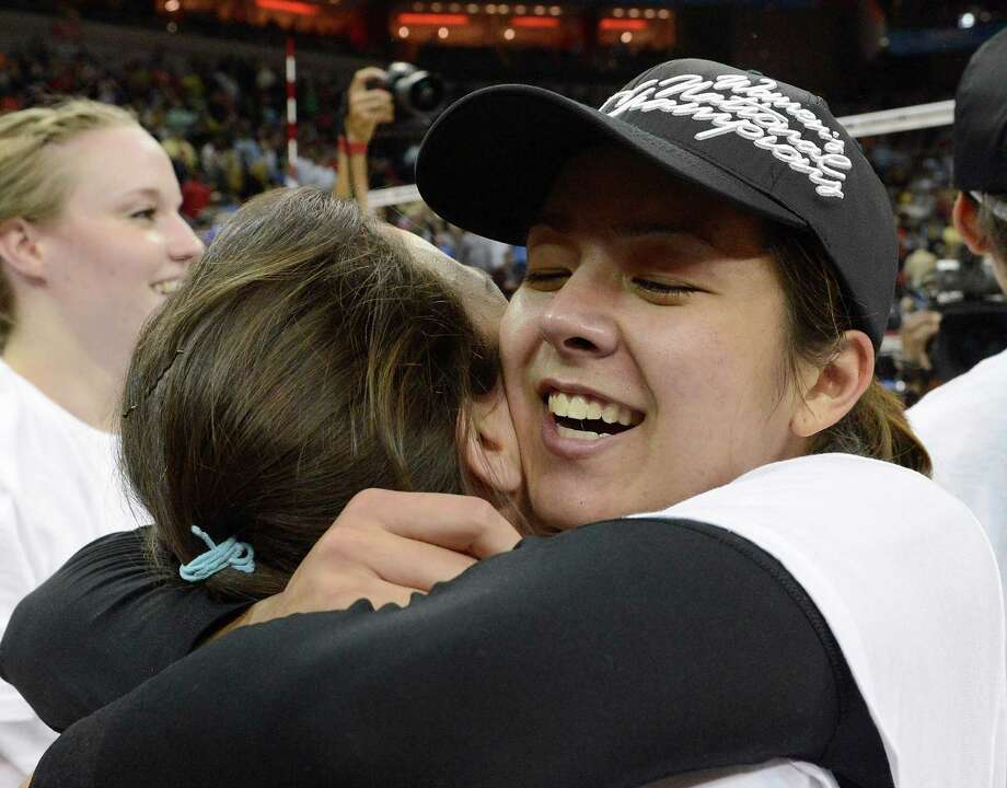 Texas' Sarah Palmer hugs a teammate after their victory in the NCAA college women's volleyball tournament over Oregon, Saturday, Dec. 15, 2012, in Louisville, Ky. (AP Photo/Timothy D. Easley) Photo: Timothy D. Easley, Associated Press / FR43398 AP
