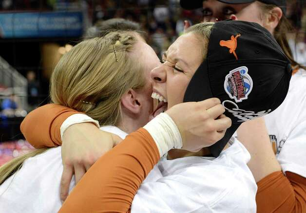 Texas' Megan Futch, right, embraces a teammate following their victory over Oregon in the NCAA college women's volleyball tournament on Saturday, Dec. 15, 2012, in Louisville, Ky. (AP Photo/Timothy D. Easley) Photo: Timothy D. Easley, Associated Press / FR43398 AP