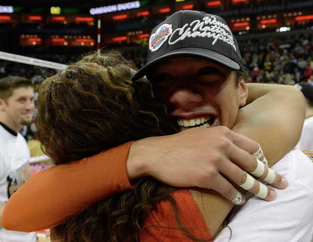 Texas' Haley Eckerman, right, embraces an assistant coach following their victory over Oregon at the NCAA college women's volleyball tournament on Saturday, Dec. 15, 2012, in Louisville, Ky.  (AP Photo/Timothy D. Easley) Photo: Timothy D. Easley, Associated Press / FR43398 AP
