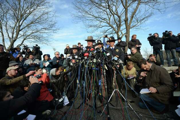 Connecticut State Police Lieutenant Paul Vance addresses a press conference on the situation following an elementary school shooting in Newtown, Connecticut, on December 15, 2012. The residents of an idyllic Connecticut town were reeling in horror from the massacre of 20 small children and six adults in one of the worst school shootings in US history. The heavily armed gunman shot dead 18 children inside Sandy Hook Elementary School, Vance said. Two more died of their wounds in hospital. Photo: EMMANUEL DUNAND, AFP/Getty Images / AFP