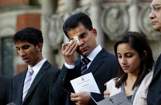 Husband of late Jacintha Saldanha, Benedict Barboza, center, reacts as he and his son Junal, 16, left and daughter Lisha, 14, speak to the media outside the Westminster Cathedral in London after a memorial service for nurse Jacintha Saldanha who took her own life after answering a hoax phone call at King Edward VII hospital where she worked, Saturday, Dec. 15, 2012. Australian radio hosts managed to impersonate Queen Elizabeth II and Prince Charles and received confidential information about the Duchess of Cambridge's medical condition, in a hoax phone call to the hospital where the pregnant Duchess was staying and which was broadcast on-air. The controversial prank took a dark twist three days later with the death of Saldanha, a 46-year-old mother of two, who was duped by the DJs despite their Australian accents. Photo: Sang Tan, Associated Press / AP