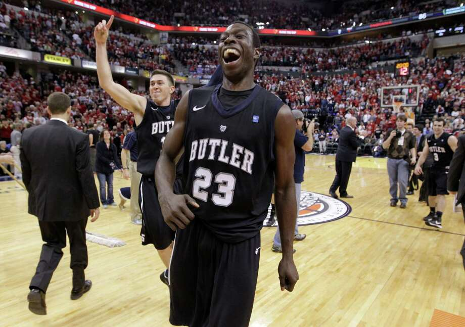 Butler's Khyle Marshall (23) and Rotnei Clarke celebrate the Bulldogs' upset of No. 1 Indiana on Saturday. Photo: Michael Conroy, STF / AP