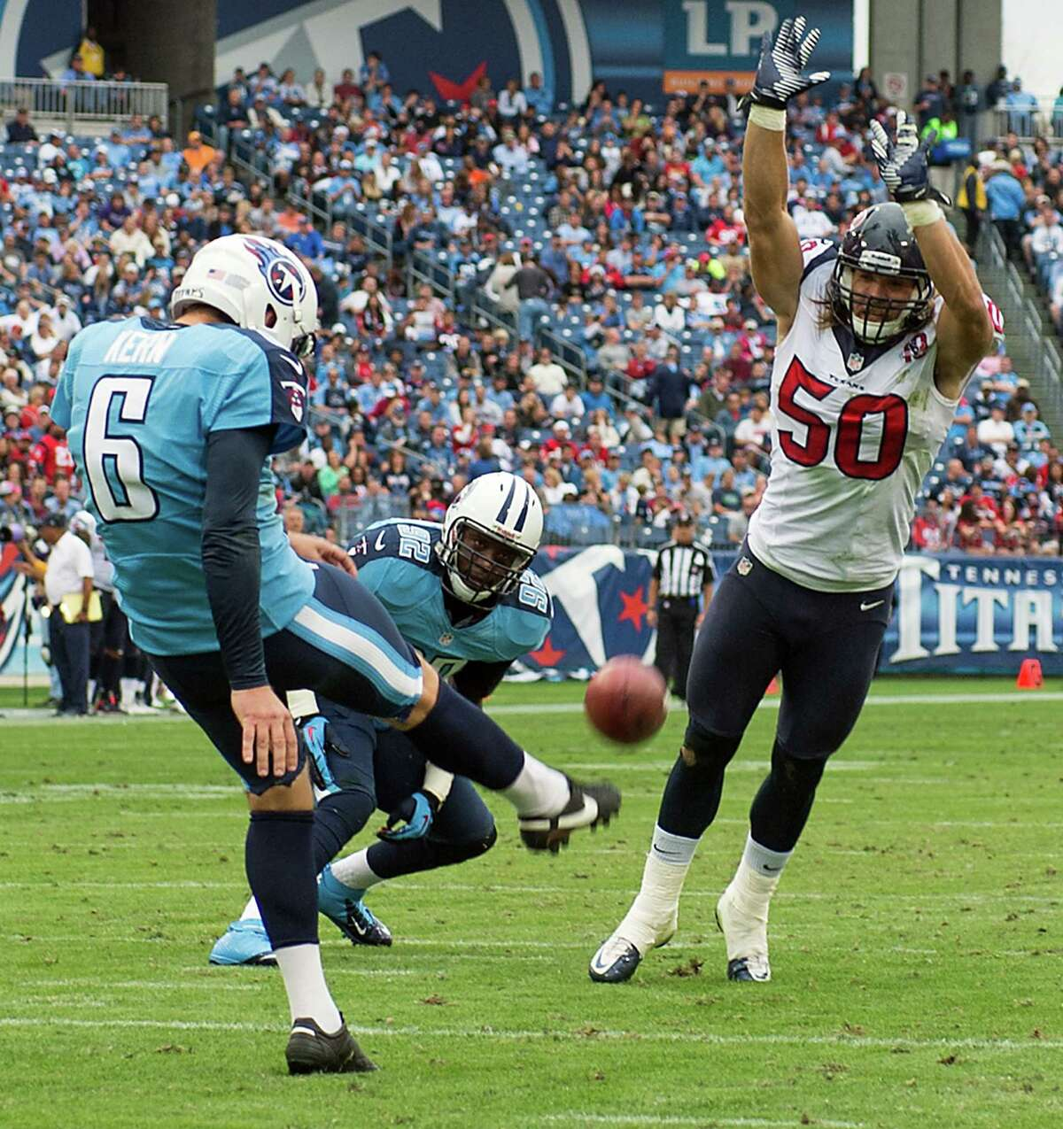 Bryan Braman, right, has become a stalwart on the Texans' special-teams units, from tackling on kickoffs to posing problems for Titans punter Brett Kern (6).