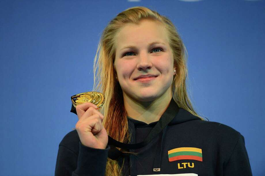 ISTANBUL, TURKEY - DECEMBER 15:  Ruta Meilutyte of Great Britain poses with her Gold medal on the podium after winning the Women's 100m Breaststroke Final during day four of the 11th FINA Short Course World Championships at the Sinan Erdem Dome on December 15, 2012 in Istanbul, Turkey.  (Photo by Clive Rose/Getty Images) Photo: Clive Rose