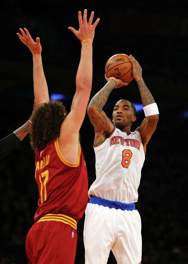 NEW YORK, NY - DECEMBER 15:  J.R. Smith #8 of the New York Knicks takes a shot as Anderson Varejao #17 of the Cleveland Cavaliers defends on December 15, 2012 at Madison Square Garden in New York City.  The New York Knicks defeated the Cleveland Cavaliers 103-102. NOTE TO USER: User expressly acknowledges and agrees that, by downloading and/or using this photograph, user is consenting to the terms and conditions of the Getty Images License Agreement.  (Photo by Elsa/Getty Images) Photo: Elsa
