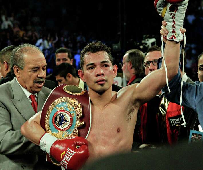 Nonito Donaire has his hand raised by referee Laurence Cole after knocking out Jorge Arce in the thi