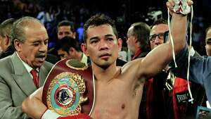 Nonito Donaire has his hand raised by referee Laurence Cole after knocking out Jorge Arce in the third round for the WBO Super Bantamweight championship, Saturday, December 15, 2012 in Houston, Texas.