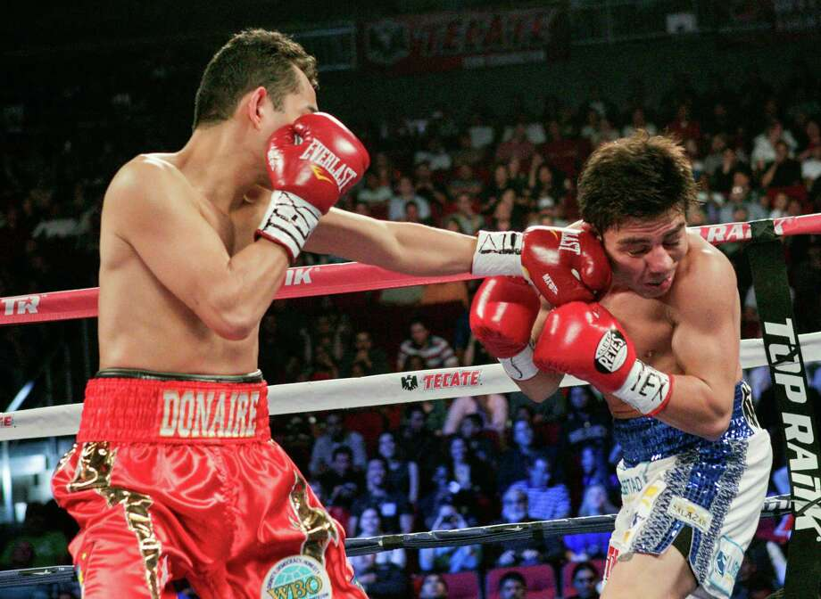 Nonito Donaire, left, lands a left jab to the head of Jorge Arce in the first round for the WBO Super Bantamweight championship, Saturday, December 15, 2012 in Houston, Texas. Donaire won in the third round by TKO. Photo: Bob Levey, Houston Chronicle / ©2012Bob Levey