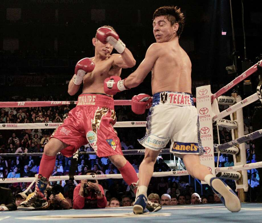 Nonito Donaire, left, lands a left cross to the head of Jorge Arce in the first round for the WBO Super Bantamweight championship, Saturday, December 15, 2012 in Houston, Texas. Donaire won in the third round by TKO. Photo: Bob Levey, Houston Chronicle / ©2012Bob Levey
