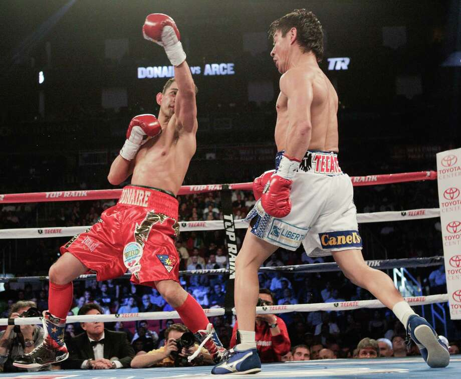 Nonito Donaire, left, misses on an upper cut to Jorge Arce in the first round for the WBO Super Bantamweight championship, Saturday, December 15, 2012 in Houston, Texas. Donaire won in the third round by TKO. Photo: Bob Levey, Houston Chronicle / ©2012Bob Levey