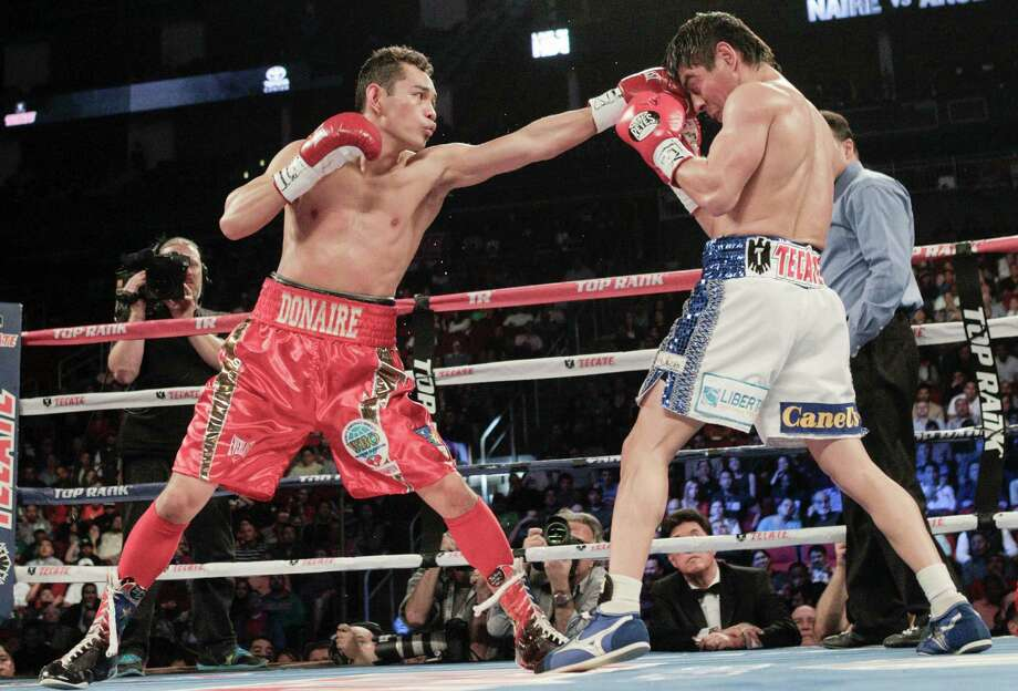 Nonito Donaire, left, lands a left jab to the head of Jorge Arce in the second round for the WBO Super Bantamweight championship, Saturday, December 15, 2012 in Houston, Texas. Donaire won in the third round by TKO. Photo: Bob Levey, Houston Chronicle / ©2012Bob Levey
