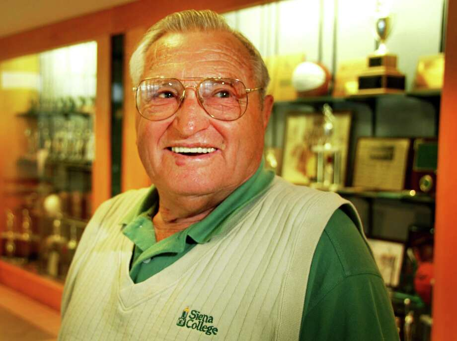 Times Union staff photo by John Carl D'Annibale:   Gino Turchi poses next to trophy cases at the Marcelle Athletics Center at Siena College Thursday morning September 20, 2007.  FOR IORIZZO SUNDAY STORY Photo: John Carl D'Annibale / Albany Times Union