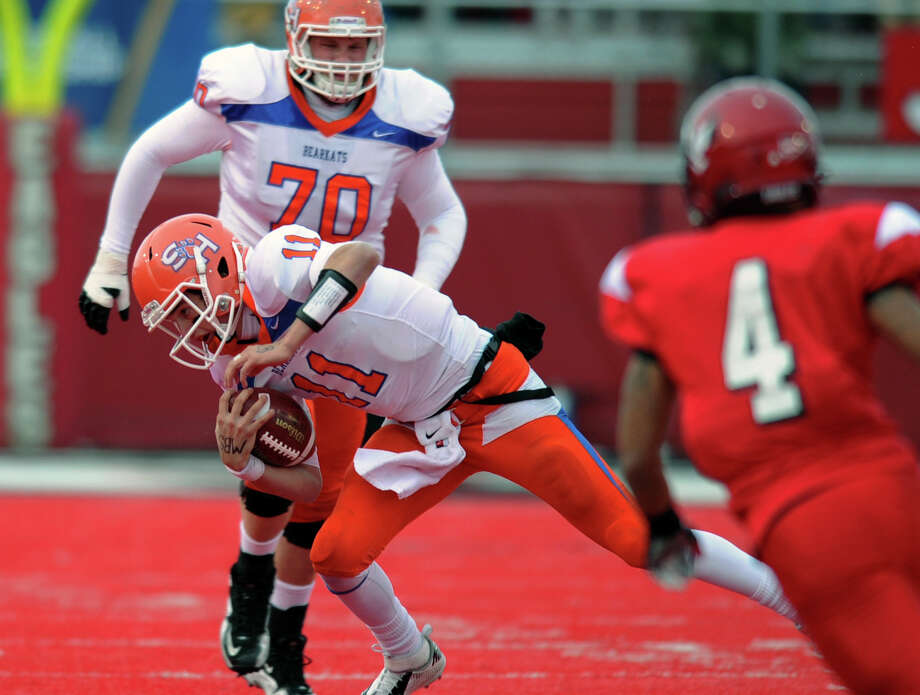 Sam Houston State quarterback Brian Bell (11) takes off  in the first half of Saturday's Football Championship Subdivision semifinal against Eastern Washington. Bell scored two rushing TDs and threw for one. Photo: Tyler Tjomsland, MBI / The Spokesman-Review