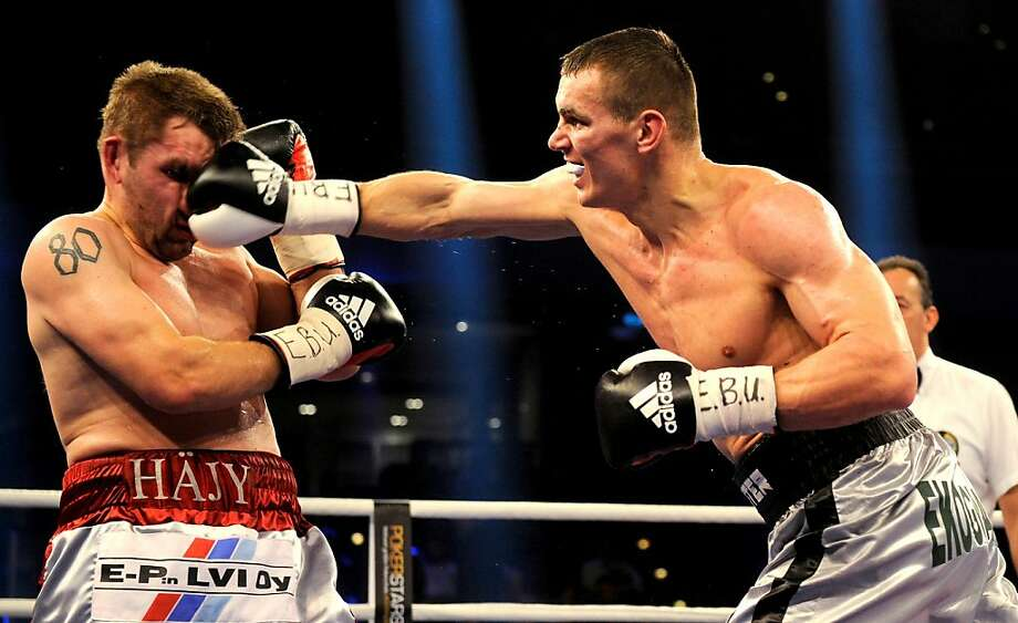 Juho Haapoja (L) of Finland and Mateusz Masternak of Poland exchange punches during the EBU European Championship Cruiser Weight title fight at Arena Nurnberger on December 15, 2012 in Nuremberg, Germany.  (Photo by Lennart Preiss/Bongarts/Getty Images) Photo: Lennart Preiss, Bongarts/Getty Images