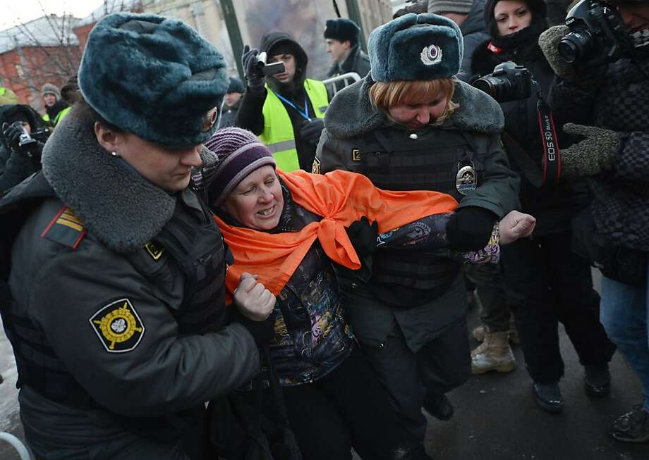 Russian police officers arrest an activist during an unauthorized opposition protest marking one year since the start of protests against Vladimir Putin, in Moscow, on December 15, 2012. Russian police arrested top opposition leaders at the anti-Vladimir Putin rally in central Moscow attended by hundreds of people in defiance of a ban by the authorities. NATALIA KOLESNIKOVA/AFP/Getty Images Photo: Natalia Kolesnikova, AFP/Getty Images