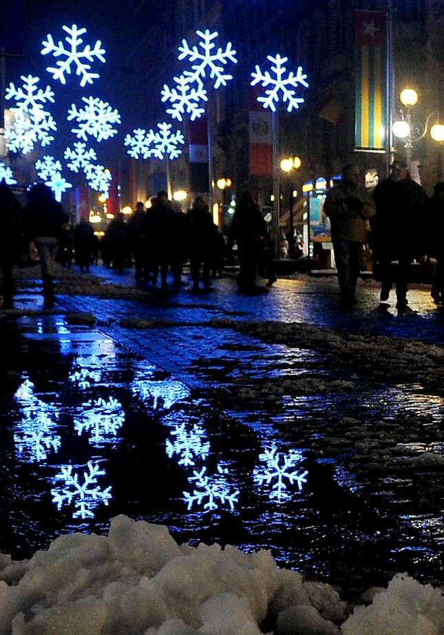 People walk in a street lighted for Christmas in the centre of Milan on December 15, 2012. TIZIANA FABI/AFP/Getty Images Photo: Tiziana Fabi, AFP/Getty Images