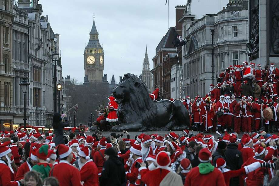 Revellers dressed up in Santa outfits gather at Trafalgar Square in London during a Santacon festival parade through the streets of London, Saturday, Dec. 15, 2012. (AP Photo/Sang Tan) Photo: Sang Tan, Associated Press