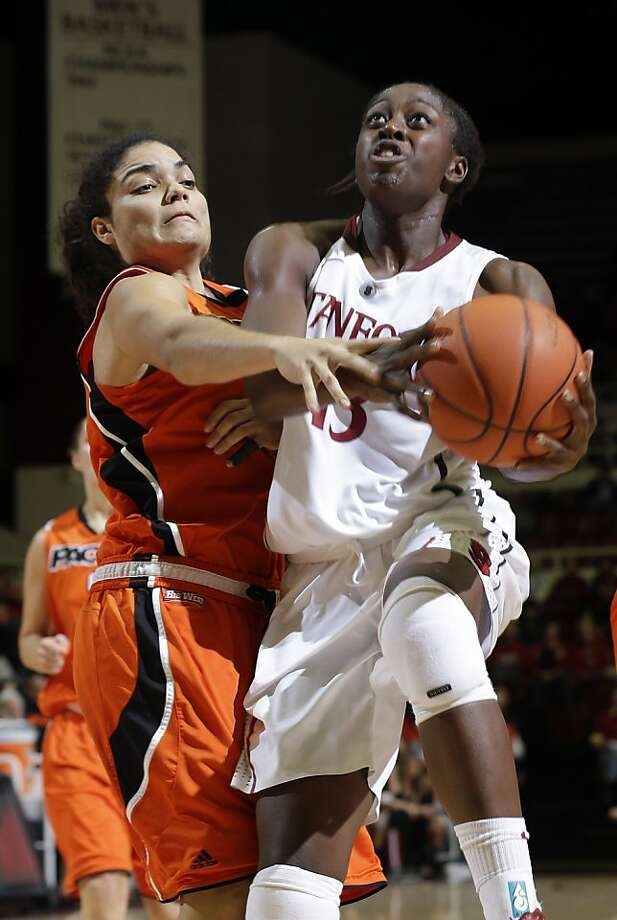 Stanford forward Chiney Ogwumike drives past Pacific's Brianna Johnson in the second half. Photo: Marcio Jose Sanchez, Associated Press
