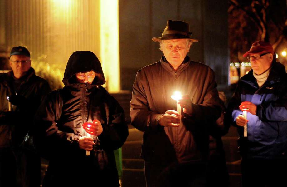 People gather on a basketball court during a candlelight vigil in remembrance of the Newtown, Conn. shooting victims at Green Lake Park in Seattle on Saturday, December 15, 2012. The vigil was held after a gunman killed his mother and then killed 20 children and six adults at Sandy Hook Elementary in Connecticut before taking his own life. Photo: LINDSEY WASSON / SEATTLEPI.COM