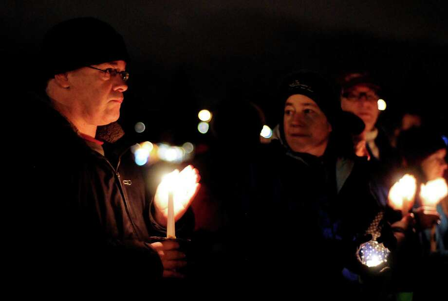 People gather during a candlelight vigil in remembrance of the Newtown, Conn. shooting victims at Green Lake Park in Seattle on Saturday, December 15, 2012. The vigil was held after a gunman killed his mother and then killed 20 children and six adults at Sandy Hook Elementary in Connecticut before taking his own life. Photo: LINDSEY WASSON / SEATTLEPI.COM