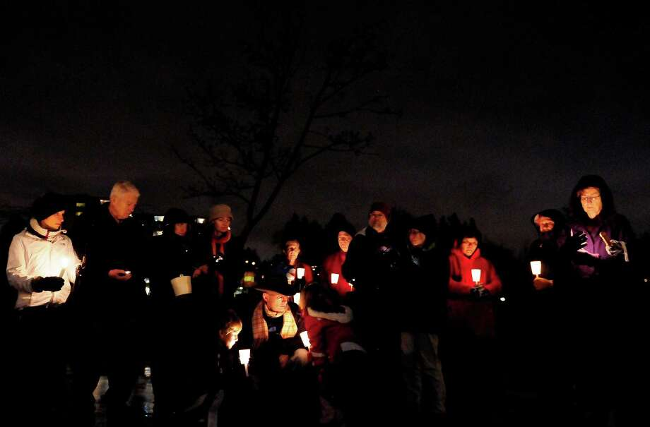 A group of about 40-50 people gather on the basketball courts during a candlelight vigil in remembrance of the Newtown, Conn. shooting victims at Green Lake Park in Seattle on Saturday, December 15, 2012. The vigil was held after a gunman killed his mother and then killed 20 children and six adults at Sandy Hook Elementary in Connecticut before taking his own life. Photo: LINDSEY WASSON / SEATTLEPI.COM