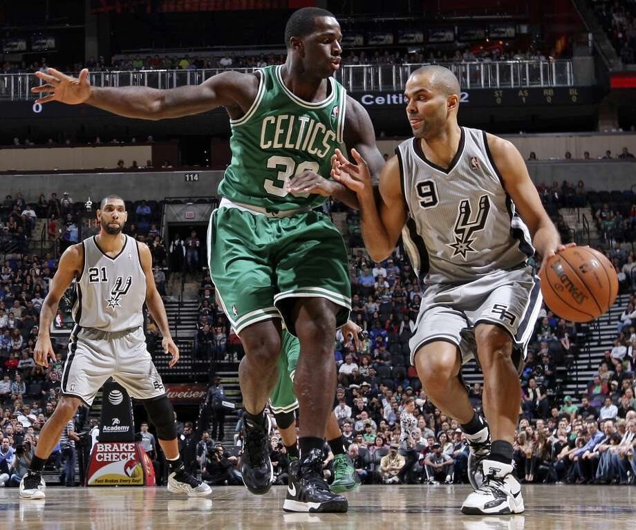 San Antonio Spurs' Tony Parker looks for room around Boston Celtics' Brandon Bass as San Antonio Spurs'  Tim Duncan looks on during first half action Saturday Dec. 15, 2012 at the AT&T Center. (Edward A. Ornelas / San Antonio Express-News)