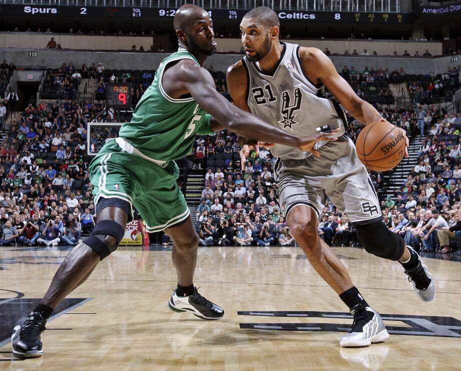 San Antonio Spurs' Tim Duncan looks for room around Boston Celtics' Kevin Garnett during first half action Saturday Dec. 15, 2012 at the AT&T Center. (Edward A. Ornelas / San Antonio Express-News)