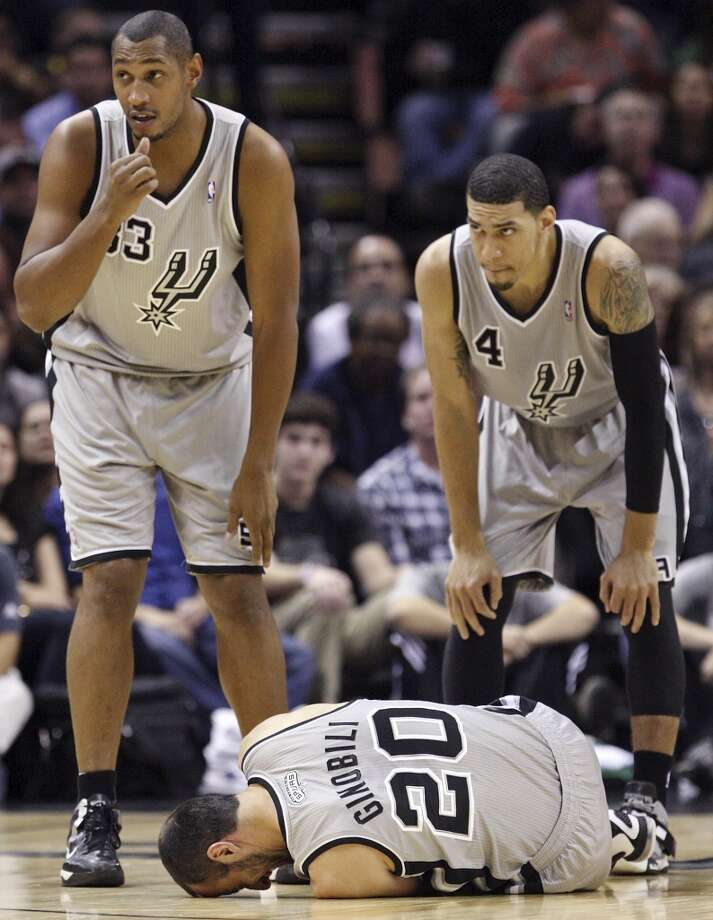 San Antonio Spurs' Boris Diaw and Danny Green look on as Manu Ginobili lies on the floor after being injured during first half action against the Boston Celtics Saturday Dec. 15, 2012 at the AT&T Center. (Edward A. Ornelas / San Antonio Express-News)