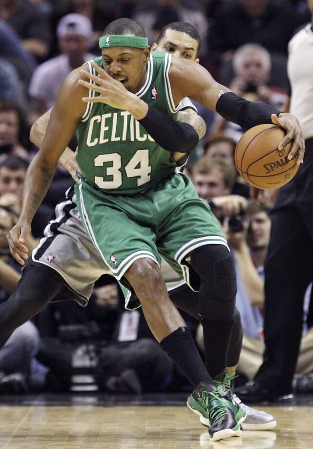 San Antonio Spurs' Danny Green defends Boston Celtics' Paul Pierce during first half action Saturday Dec. 15, 2012 at the AT&T Center. (Edward A. Ornelas / San Antonio Express-News)