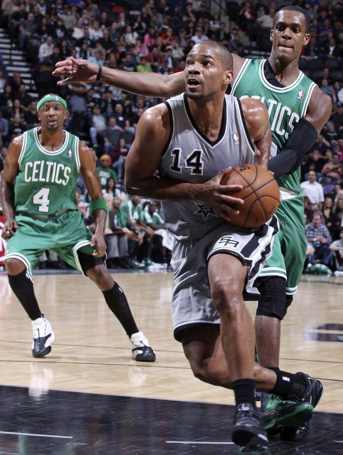 San Antonio Spurs' Gary Neal drives around Boston Celtics' Rajon Rondo during first half action Saturday Dec. 15, 2012 at the AT&T Center. (Edward A. Ornelas / San Antonio Express-News)